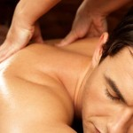 Image of massage therapist massaging man