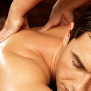 Image of a man enjoying back massage